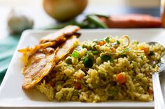 colombian arroz con pollo and fried plantains
