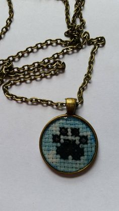 Cross stitch paw print pendant necklace by mydisheveledducks