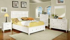 white queen bed with storage and there are nightstand and dressers