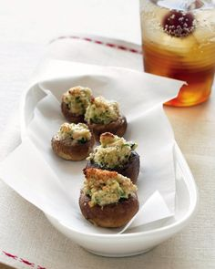 Goat-Cheese Stuffed Mushrooms | Goat cheese seasoned with garlic, parsley, and hot pepper is stuffed into button mushroom caps, topped with fresh breadcrumbs, and baked until lightly browned. This easy appetizer recipe can be customized to your liking with shallots, chopped olives, or toasted nuts.