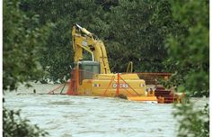 An excavator sat swamped with water as it was engulfed as the Bow River burst its banks at the Southland Dog Park in some of the worst flooding in Calgary in years on June 21, 2013. Photograph by: Colleen De Neve, Calgary Herald