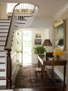 Lovely, classic center hall / foyer Love the oil painting and staircase.  Is it just me or is console too wide?