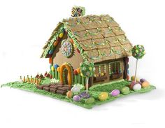This house looks like the fairy tale house in Hansel and Gretel (but less sinister). Love the cake pops as trees and the coated almonds as stones lining (and what are those steps - mini-Milky Way bars?)