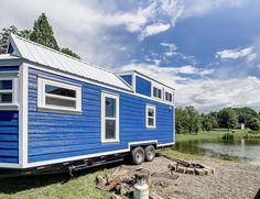 The Kokosing: a beautful blue tiny house from Modern Tiny Living of Columbus, Ohio. The 256 sq ft home has a modern/rustic aesthetic with all the comforts of home! Rustic Cafe, Rustic Restaurant, Rustic Cottage, Rustic Farmhouse, Modern Rustic, Rustic Office, Rustic Bench, Kitchen Rustic, Rustic Shelves