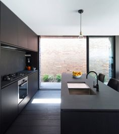 Renovated house in Sydney with dark furnishings