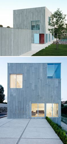 12 Minimalist Modern House Exteriors From Around The World | Grey siding covers this exterior of this home that features light blue shutters to create a playful yet minimal appearance.