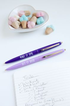 "Pen Set A pen set to help you set your goals and conquer the world. - Purple pens - Bic ballpoint - 0.5""x 5.5"" - packaged in cello bag with backing"