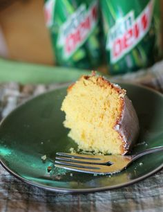 MOUNTAIN DEW CAKE  Ingredients    1 (18.25 oz) box Lemon Cake  1 (12 oz) can Mountain Dew  4 eggs  3/4 cup vegetable oil  3 cups powdered sugar  1/4 cup + 1 Tbsp Mountain Dew