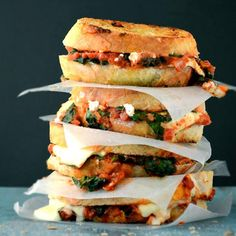 Grilled Cheese with Spinach-and-Tomato Sauce | Call it an adult version of the grilled-cheese sandwich—slices of country bread layered with mozzarella, goat cheese, and tomato-sauced spinach and toasted to a golden brown.