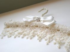 Venetian Lace ...Satin Padded Bridal Hanger... The perfect Wedding and Bridal Shower gift. Stunning lace , pearls and rhinestone trim. Every brides gown should be hung a on a beautiful hand jeweled Vogue Bridal Hanger. A true artisan piece of art.... for the most beautiful dress