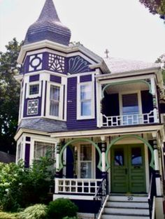 Purple with white trim Victorian home