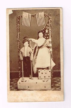 Civil War CDV Boy Girl Greiner Mache Dolls 1 Leg Boy Crutches US Flags Tamaqua   eBay GREAT early CDV with Greiner or Greiner type dolls.  The little boy has crutches and is missing one leg is being presented a wreath by the girl (Liberty?). American flags around the podium.  Little boy doll looks to be dressed as a Zouve.