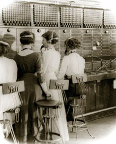they have a speaker attached around the neck...Switchboard operators at the Sydney GPO Switchboard, 1913