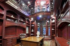 So eye-catching is the 2 story STUDY (21 X 14) !  Notice the wrought iron circular staircase, mullioned windows /transoms above, built-in bookshelves/decorative carved fronts, built-in desks/filing drawers and hardwood flooring.