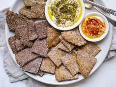 These easy crunchy flaxseed crackers come together quickly in one bowl and with only a handful of ingredients! No fancy equipment, they're oven baked!