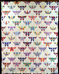 """The Quilt Index- 1930's butterfly quilt. Uses solid color with scraps for the """"ring"""" on the wings. Another one I want to make."""
