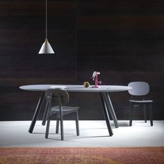 'Pixie' Oval or round dining table with legs in turned and oiled beech or lacquered. The wood used comes from reforestation areas and the oil is 100% non-chemical. Top in MDF, 30 mm painted in white, black, silk gray or dusty gray colors. To ensure resistance to the top, the lacquering is done at multiple layers.