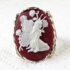 Butterfly Fairy Cameo Ring   Lovely and large resin molded fashion cameo hand sculpted in the finest Jeweler's .925 Sterling Silver custom designed setting.  Slightly raised intricate detailing for th