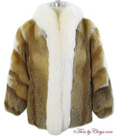 Red and White Fox Jacket #RWF772; $1000; Excellent Condition; 8 - 12 Petite. This is a gorgeous genuine natural red fox fur jacket with white fox trim. It features a white fox tuxedo collar, built-in shoulder pads, and the sleeve ends are very lightly elasticized. The pelts on the sleeves are sewn on a diagonal and they have a white fox accent stripe for even more flair. The markings of the fur are fantastic. This is a very special fur jacket that will add oomph to your wardrobe.