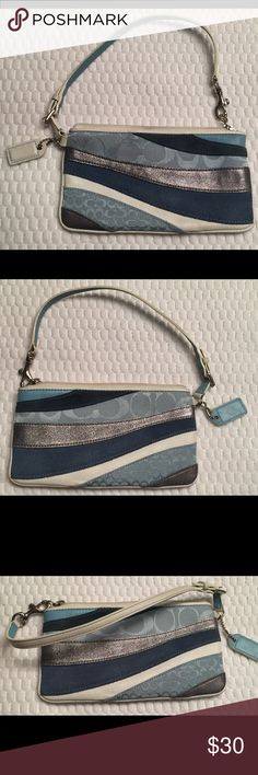"Coach Blue Patchwork Striped Wristlet Nice used Coach wristlet. Patchwork blue, white and metallic stripes with signature C's. Silver tone hardware, zipper closure, 6"" attached strap with dog leash clasp.  Approx. size: 7"" L x 4 1/4"" H. Strap is lightly dirty but overall nice condition. Coach Bags Clutches & Wristlets"