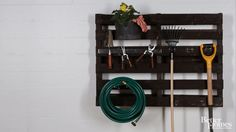 Upcycle a cast-off pallet into a garden tool organizer to hang in your garage or shed. Simply stain the pallet with your choice of stain color and attach pegboard wall hooks to hold your tools.