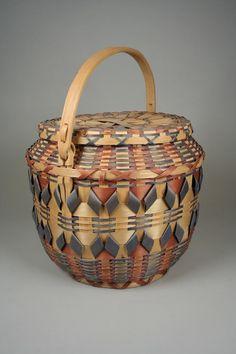 Lidded Basket | ca. 1940. Winnebago, Wisconsin | Ash splint, wood, pigment