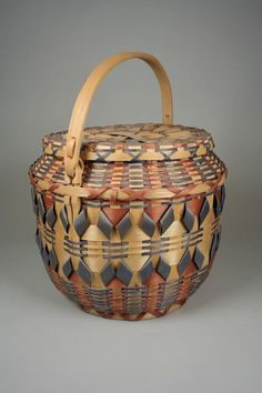 Lidded Basket | ca. 1940.  Winnebago, Wisconsin | Ash splint, wood, pigment