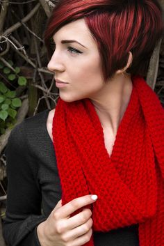 Potential cut and color.  Cool deep red + overgrown pixie cut