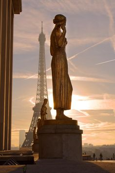 Eiffel Tower viewpoint from Trocadéro esplanade. In the forground, the gilt bronze sculpture, entitled Youth