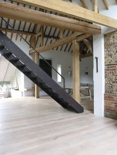 Dream interior old barn, warehouse, loft, exposed beams, natural wood floors, steel stairs. barefootstyling.com