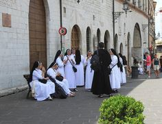 nuns eating gelato in Assisi, Umbria