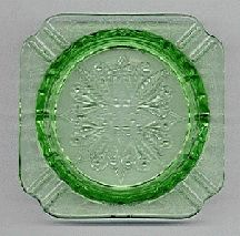 Adam Green by the Jeannette Glass Company (1932-1934). The square shape surrounding a circle makes it easy to recognize. It was also made in pink.