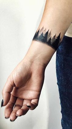 Thinking about getting a tree tattoo? We've collected 21 meaningful tattoo ideas to help you pick your favorite design. Arm Cuff Tattoo, Ankle Band Tattoo, Black Band Tattoo, Skull Hand Tattoo, Arm Band Tattoo For Women, Ankle Tattoos For Women, Sleeve Tattoos For Women, Tattoos For Guys, Nature Tattoo Sleeve Women