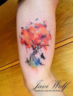 Tree Tattoo with a Man swinging: Getting this tree tattoo inked on your body would symbolize that you love your life, and enjoy every aspect of it with your roots too.