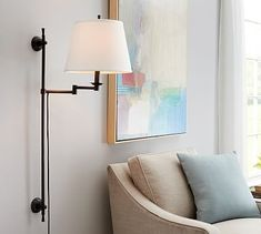 Elise Adjustable Sconce from Pottery Barn, very narrow and  would work great in the powder room...can be wired vs plug in - would put behind top holder - would see a bit of wire.  Price is $319 for a set of 2