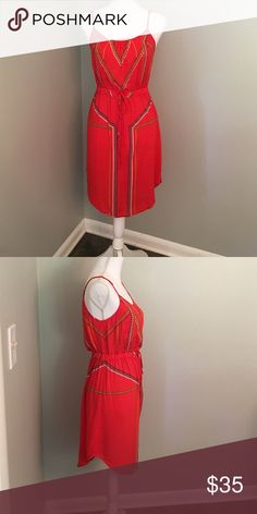 Adorable High Low Dress High on the sides and low in the front. Gorgeous coral red color with blue, green, yellow and white accents. Adjustable straps. Worn once. Perfect condition with no stains or tears. Made for Impulse Dresses