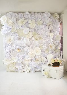 DIY Paper Flower Wall  These blue, skin and white roses are all put together in a huge bunch all made with paper. These lifeless paper flowers are used in making this classic backdrop certainly for some room that we intended to decorate. How about giving it a try through this handy DIY project?