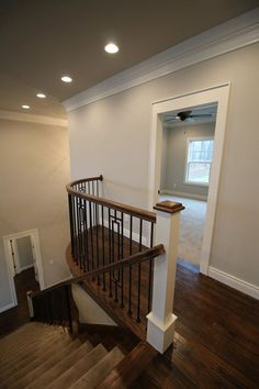 Stairwell with Benjamin Moore White Dove Trim, Hand scraped white oak floors with Jacobean stain, and Benjamin Moore Collingwood walls.
