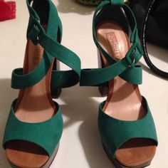 Green scrappy shoessale1 HR Super clean Peep toe platform suede shoes with criss cross straps. 5.5 embossed gator heels. Signature name on bottom in gold. Super nice heels. Only worn once Schultz Shoes Platforms