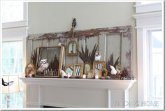 Fall Mantel - I dig all the frames, mirrors and pheasant feathers