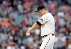 SAN FRANCISCO, CA - JUNE 11: Matt Cain #18 of the San Francisco Giants takes a moment on the field after giving up a two-run single to Adam LaRoche #25 of the Washington Nationals in the first inning at AT&T Park on June 11, 2014 in San Francisco, California. (Photo by Ezra Shaw/Getty Images)