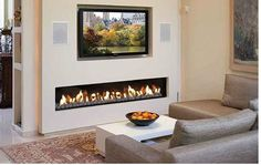Contemporary electric fireplace designs with TV above for small living room: Electric Fireplaces Ideas, Tv Above Fireplace, Linear Fireplace, Fireplace Inserts, Living Room With Fireplace, New Living Room, Fireplace Design, Living Room Decor, Small Living, Fireplace Ideas