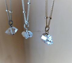 Necklace made with gorgeous genuine raw Herkimer Diamond and finished with Stellite style chain. This style can be made in 14k gold filled, sterling silver or oxidized sterling silver. Matching earrings can be ordered as a set as well. Please choose options from drop down box at checkout.  What is Herkimer Diamonds? Herkimer Diamonds are double-terminated quartz crystals first found in Herkimer, New York. Incredibly, they are close to five hundred million years old. Magnificent works of…