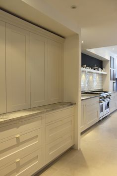Roundhouse bespoke kitchen in Fulham showroom handle ideas