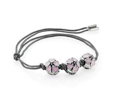 The new Cherry Blossom charm on a grey textile string. A simple yet romantic look! #pandora #springsummer #SS13