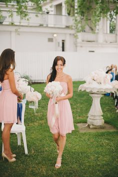 soft pink bridesmaid dress with white peony bouquet