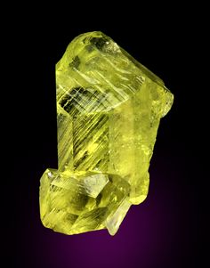 Brazilianite, NaAl3(PO4)2(OH)4, Linópolis, Divino das Laranjeiras, Minas Gerais, Brazil. Dimensions: 2.8 x 1.6 x 1 cm. Superb glassy gem quality yellow complex brazilianite crystal without matrix. Complete all around and a floater with no points of attachment. Copyright: © Dan & Diana Weinrich Minerals
