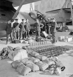 Air and ground crew of No. 202 Squadron RAF check equipment and ordnance issued to Consolidated Catalina Mark I, AJ159 'AX-B', on the slipway at North Front, Gibraltar, in preparation for a patrol. Aerial Camera, Experimental Aircraft, Flying Boat, Ww2 Aircraft, Royal Air Force, Cata, Armed Forces, Vintage Travel, World War Ii