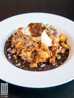 Start your day by enjoying this Carnitas Hash from Nueve Mexican and Grill!