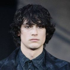 Rebellious messy style for men with black hair